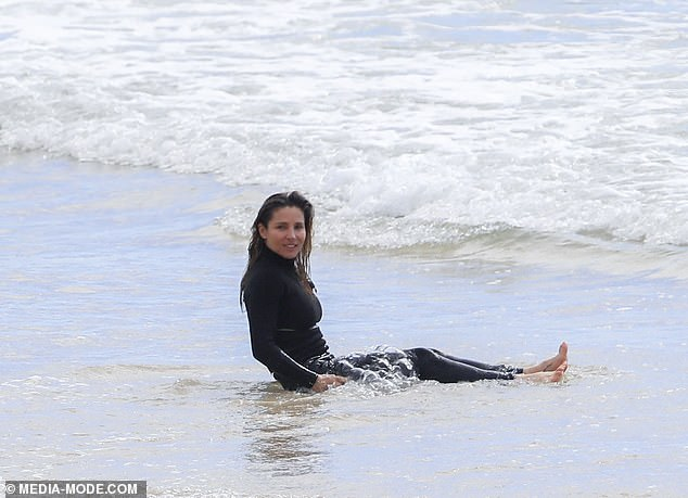 Warming up? Elsa sat on the shore at one point and let the waves crash over her