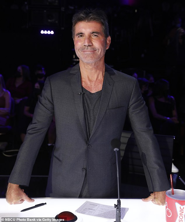 Difficult act:Even though one of the dancers fell over, the show's executive producer and judge Simon said that misstep actually made their act more exciting because it showed how difficult the act was