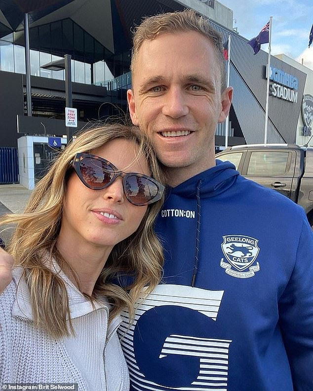 The long goodbye: Brit Selwood (pictured left) shared her heartbreaking goodbye from husband Joel Selwood (right) as the Geelong captain entered a hard lockdown in Melbourne's GMHBA Stadium on Monday