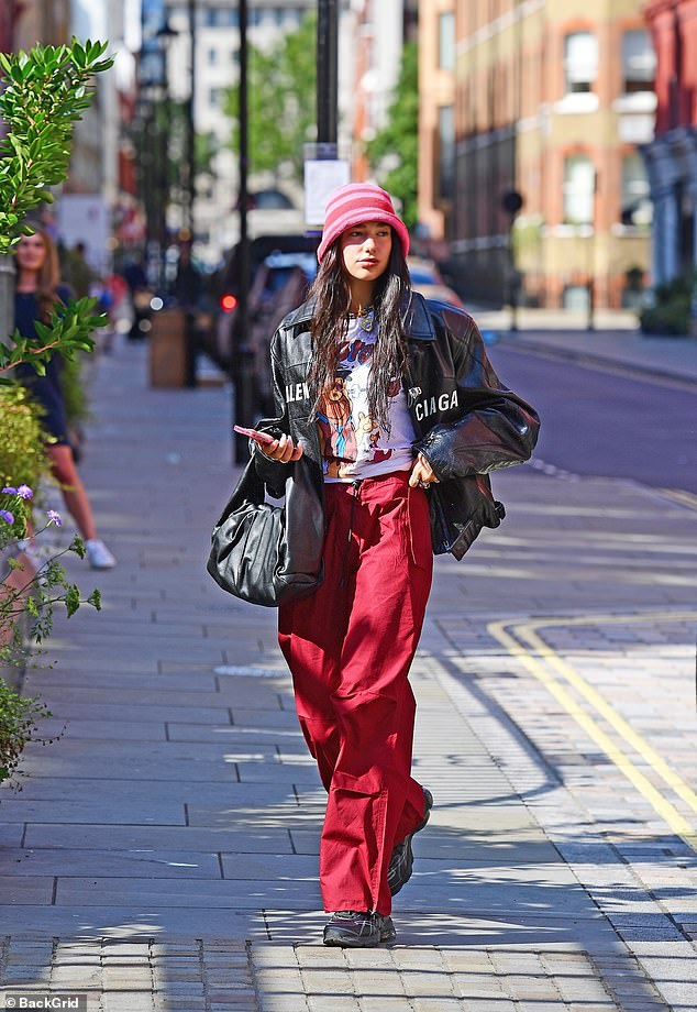 Sunny side up: Dua enjoyed the bright London weather as she strolled along