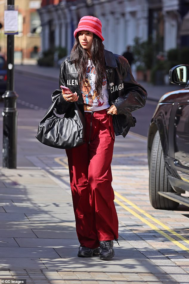 Bag it up:The singer carried her belongings in a large leather tote slung over her elbow and accessorised with multiple silver rings and a colourful beaded necklace