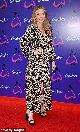 Looking good: Candice looked stylish in an animal print midi dress