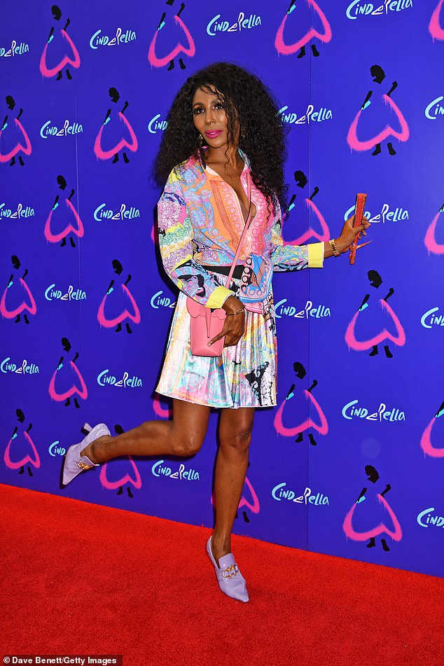 Eye-catching:Sinitta showed off her sense of style in a bright multi-coloured shirt and a matching mini skirt