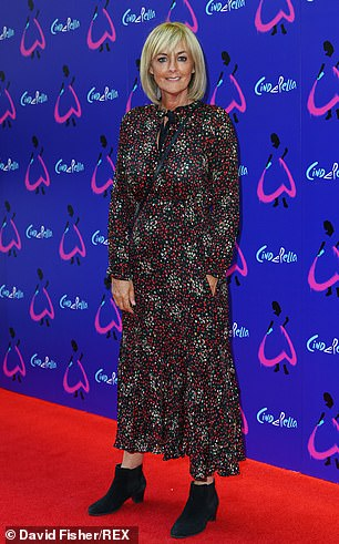 Loose Women: Jane Moore attended the show in a black midi dress with a red and white floral print