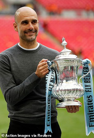 The Spaniard holds the FA Cup trophy in 2019