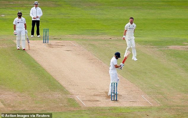 Anderson celebrates after taking the vital wicket of India captain Kohli in the morning session