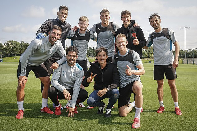 Marquez (middle) was invited to watch a session with Guardiola's squad on Wednesday