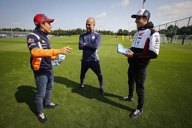 Guardiola (middle) has met Marquez (left) before and hopes to see more of him in motorsport