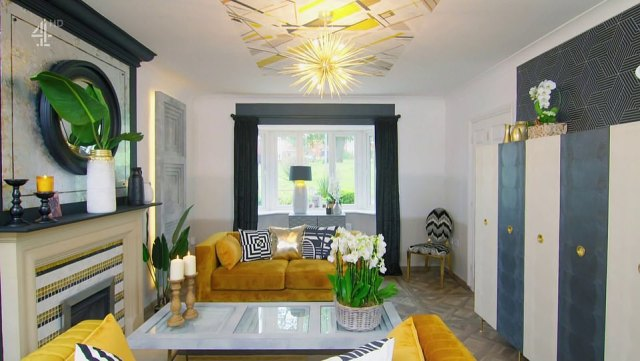 The maximalist designer opted for a room featuring splashes of black decor, an elaborate geometric mural and faux concrete panels