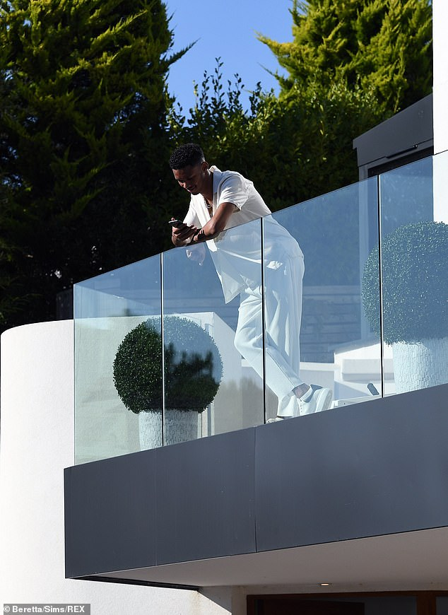 Anti social? Roman seemed to keep himself to himself as he scrolled on his phone alone on the balcony