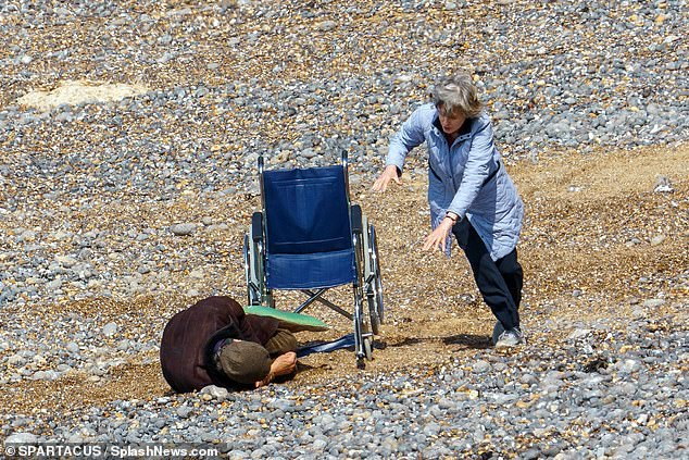 Upcoming: Scenes looked to be dramatic, as Rupert laid on the beach after previously sitting in the wheelchair
