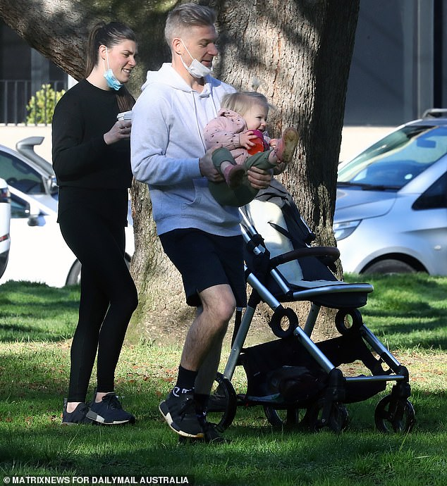 Victorian premier Dan Andrews angered many parents when he closed children's playgrounds earlier this month (pictured, a family out and about in Melbourne)