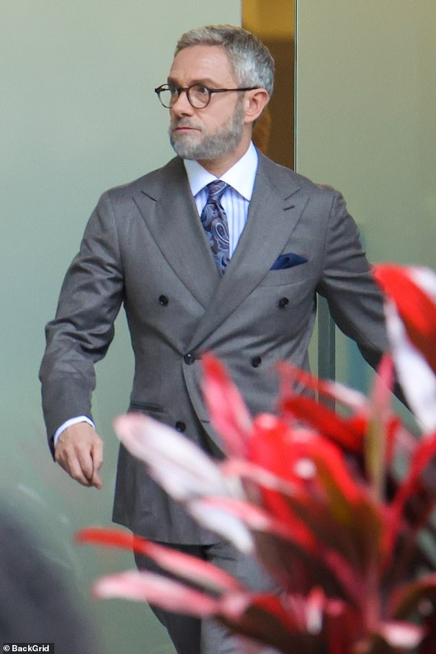 Martin's look:The British actor was spotted walking through the set wearing a white and grey striped dress shirt with a patterned grey tie