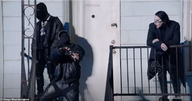 Masked up: West was seen wearing a leather outfit and a black face mask