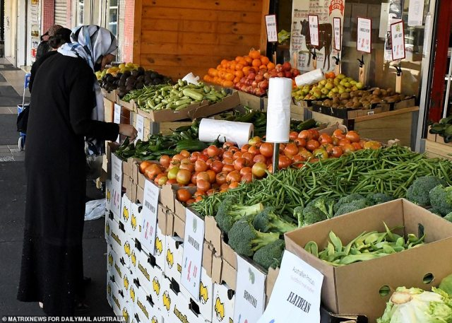 A woman shops for fruit at Guildford during lockdown
