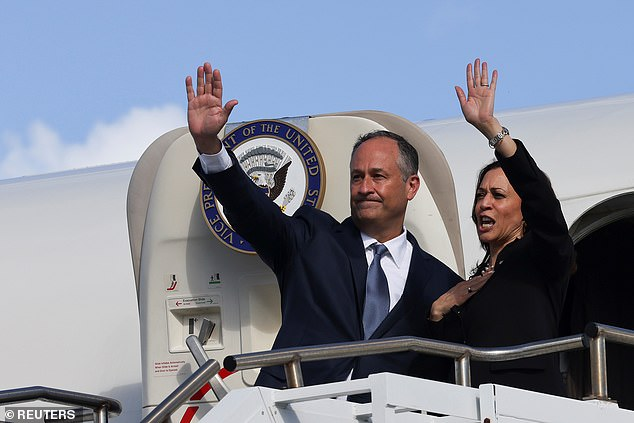 Harris and her husband Doug Emhoff are pictured boarding Air Force Two in Honolulu, Hawaii, on August 26 while en route back from her trip to Asia