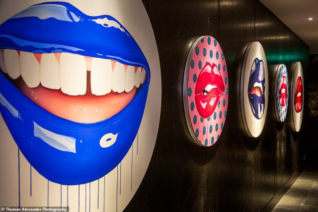 Bold paintings of voluptuous lips by contemporary artist Sara Pope line the walls of South Place Hotel