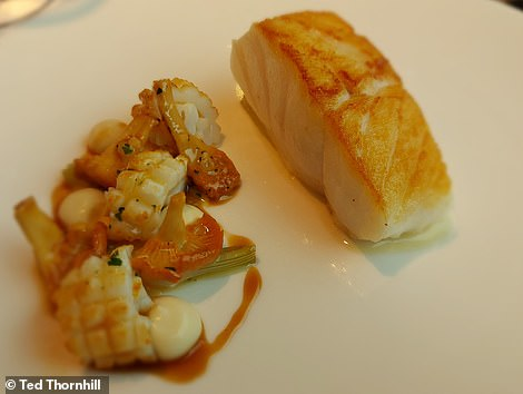 A slice of Newlyn cod with a dainty diorama of Scottish girolles, line-caught squid and Alsace bacon jus gras