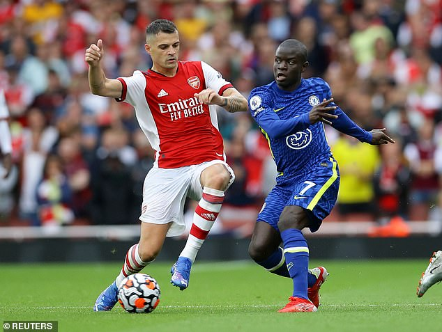 N'golo Kante (right) could be key to Chelsea pipping Liverpool to victory on Saturday