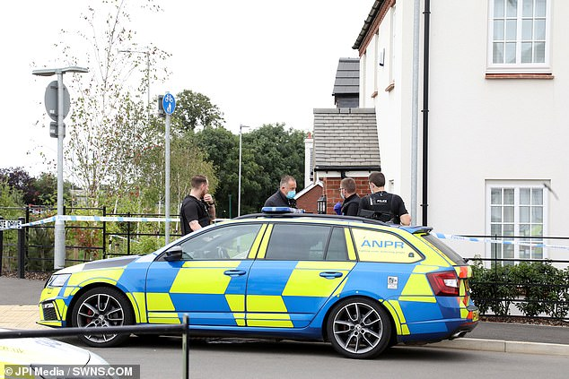 Residents said they were shocked when police (pictured on Saturday) arrived at the house