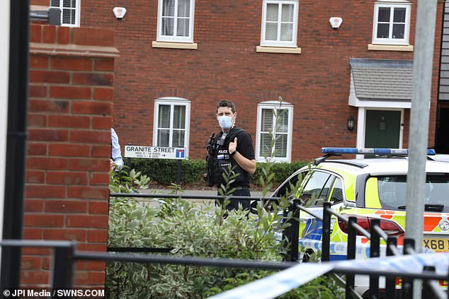 Northamptonshire police officers set up a cordon around the home, the walled garden and shared garage as forensic examination was carried out. Pictured: Police on scene on Saturday