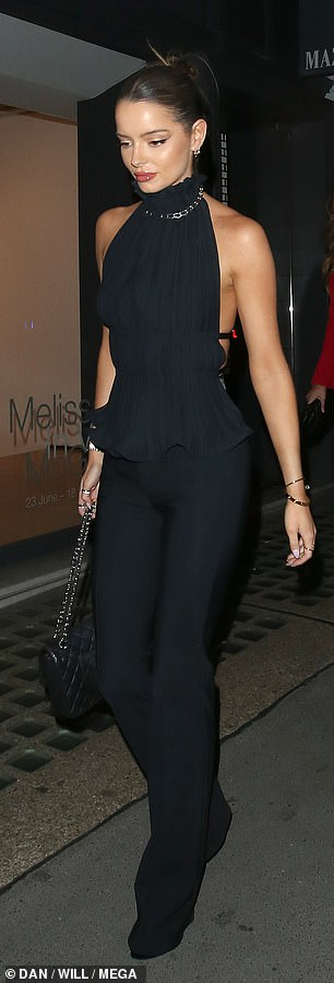 Fashionista: She teamed her sleek ensemble with towering black Christian Louboutin heels and a chic black handbag