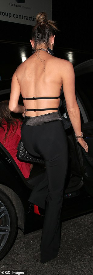 Flaunt:Maura showed off her toned back and the cluster of stars tattoo on the back of her neck as she climbed into a waiting car