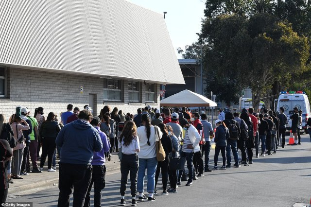 Hundreds of people wait in line for their Covid vaccine at the South Western Sydney vaccination centre at Macquarie Fields