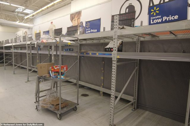 City officials said residents need to be prepared for prolonged power outages, and asked elderly residents to consider evacuating. Collin Arnold, the city's emergency management director, said the city could be under high winds for about ten hours. A Walmart in New Orleans is pictured here with nearly-depleted stocks