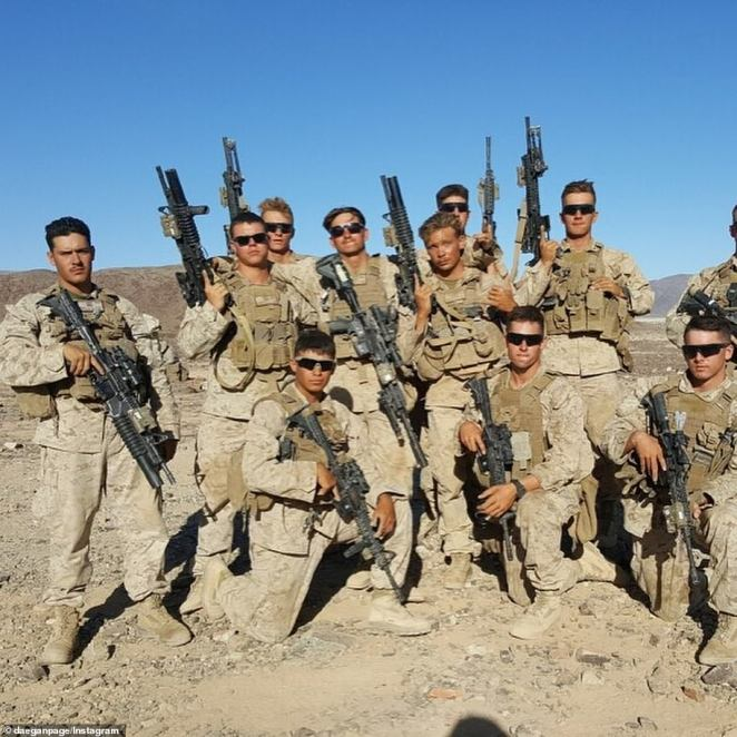 Page, third from the left, rear, was drawn to the sense of brotherhood within the Marine Corps