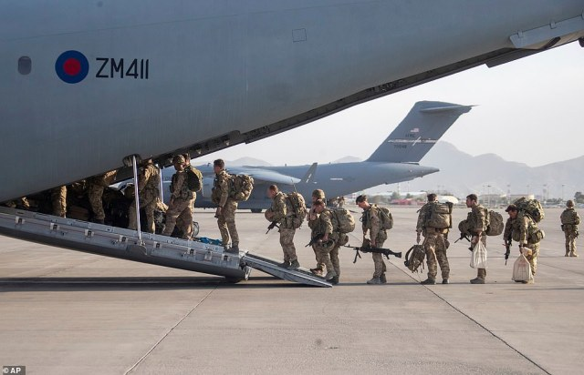 In this handout photo provided by the Ministry of Defence, UK military personnel onboard a A400M aircraft departing Kabul, Afghanistan, Saturday, August 28, 2021
