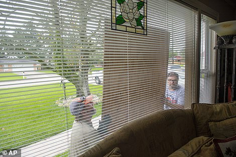 Neighbors are helping each other board windows today in Morgan City, Louisiana. The National Hurricane Center said that the projected damage in Louisiana will be 'catastrophic'