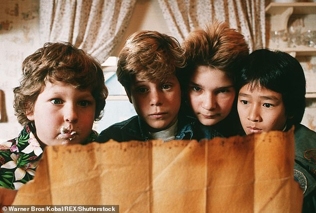 Breakout: Astin (seond left) first got widespread recognition for his role in The Goonies (1985) alongside fellow child actor Jeff Cohen, Corey Feldman and Ke Huy Qua