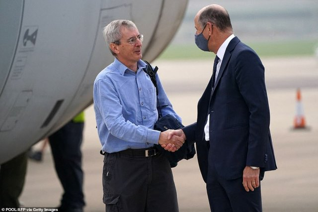 Britain's Ambassador to Afghanistan, Laurie Bristow is greeted by Philip Barton, Permanent Under-Secretary of the Foreign, Commonwealth and Development Office, after disembarking a Royal Air Force Voyager at RAF Brize Norton