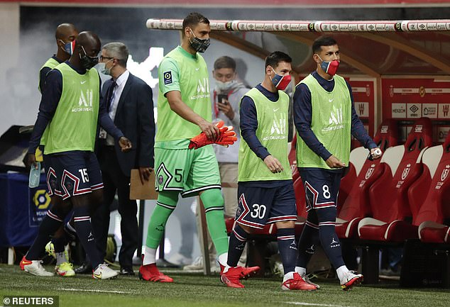 Lionel Messi (second from R) looked nervous as he prepared to make his PSG debut at Reims