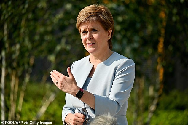 Scottish First Minister Nicola Sturgeon (pictured) is self-isolating after coming into contact with someone who has tested positive for coronavirus, she has revealed on social media