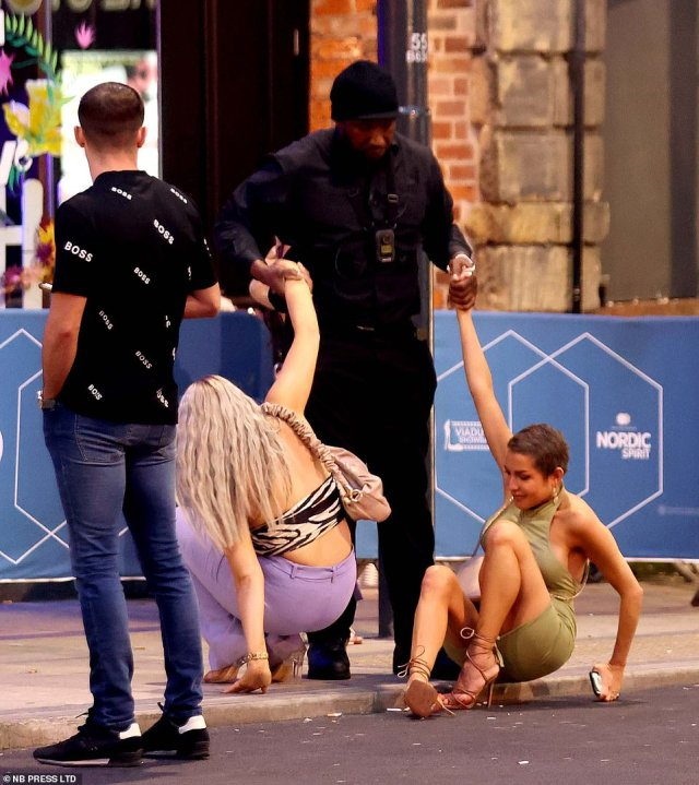 Some party-goers are helped to their feet as they join hundreds of others and take advantage of the three-day bank holiday weekend