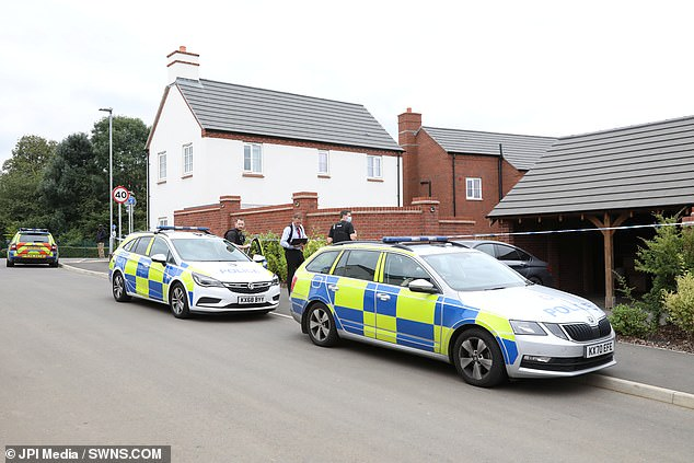 Police cars remained at the scene on Saturday as forensic investigations got underway