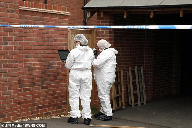 Pictured: Northamptonshire forensic officers were at the scene at Slate Drive on Saturday