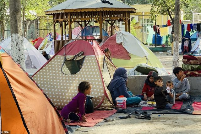 Internally displaced Afghan families live in a temporary shelter at a park in Kabul, Afghanistan