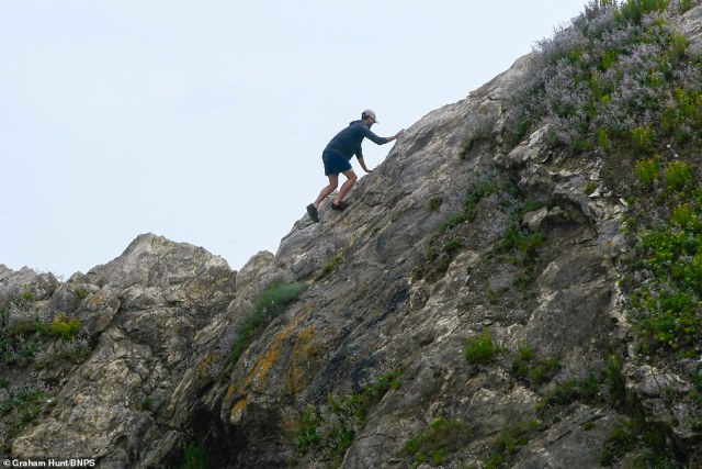 At least seven people were seen to free-climb up the rocky beauty spot of Stair Hole at Lulworth Cove in Dorset today
