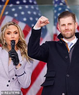 Eric Trump and his wife Lara raise their fists at the 'Stop the Steal' rally