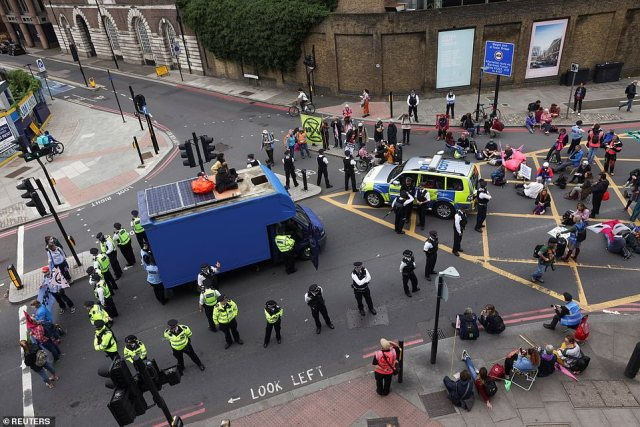 Activists also lay down on the junction north of Tower Bridge and attached themselves to a blue van, causing further disruption