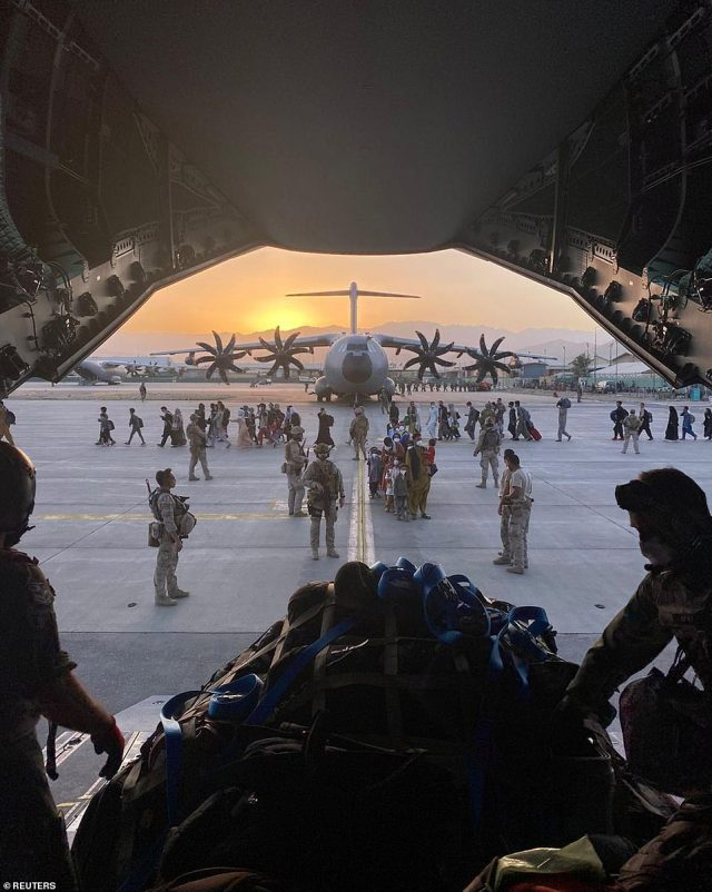 Pictured:Afghan collaborators, their families, Spanish soldiers and members of the embassy board a Spanish military plane as part of their evacuation, at the Hamid Karzai International Airport in Kabul, Afghanistan, August 27, 2021