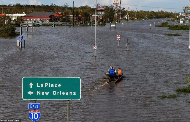 Highway 51 was flooded in LaPlace, Louisiana with rescue crews having to take a boat to reach people stuck in their homes
