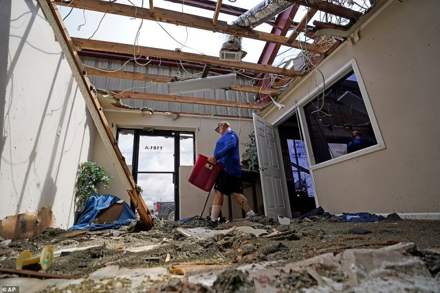 Rene Hebert cleans out the family's destroyed offices in Houma, Louisiana
