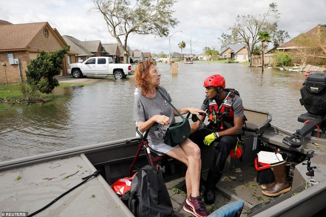 A member of a rescue team helped evacuate a woman after Hurricane Ida made landfall in LaPlace, Louisiana