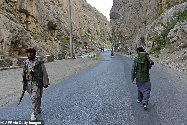 Blinken mentioned land routes through Afghanistan's rough terrain. Here Afghan resistance movement and anti-Taliban uprising forces personnel patrol along a road in Rah-e Tang of Panjshir province on August 29, 2021