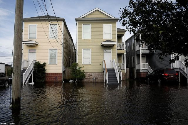 The image above shows a row of flooded homes in New Orleans, Louisiana on Monday