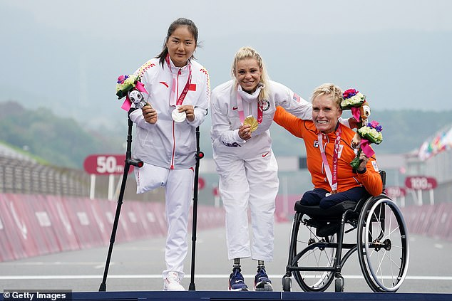 Masters (centre) finished more than a minute clear of any of her cycling competitors in Japan